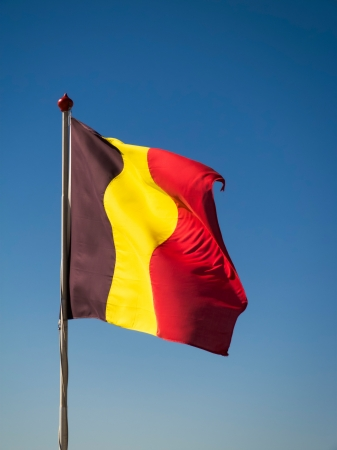 Belgian flag pole on clear blue sky photo