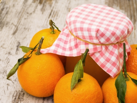 clementine fruit: Clementine jam jar with fruit on wooden table