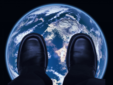 On top of the world concept with shoes on earth photo