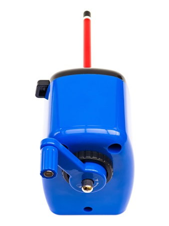 parer: Top view of a blue hand cranked pencil sharpener on white Stock Photo
