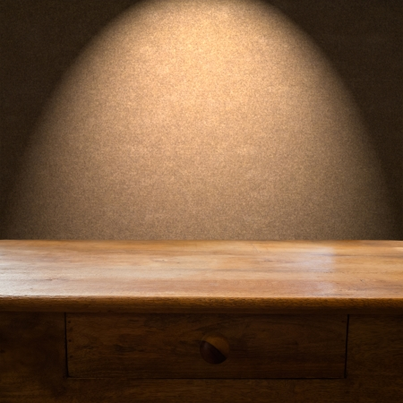 old desk: Wooden table with drawer and light backdrop Stock Photo