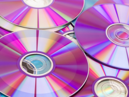 discs: Stack of purple rewritable dvd collection Stock Photo