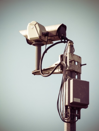 Surveillance camera, toned image with vignette photo