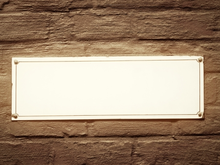 Vintage blank white street sign on brown wall photo