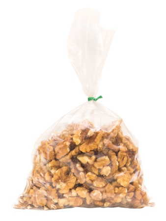 Walnuts in plastic bag isolated on white  photo