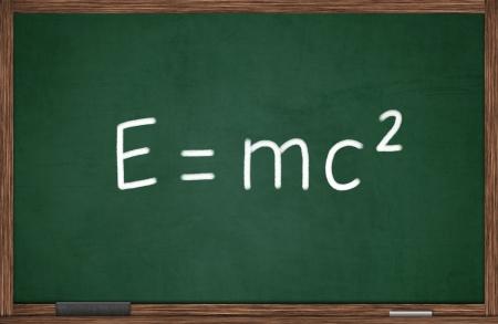 E=mc2 formula written on chalkboard photo