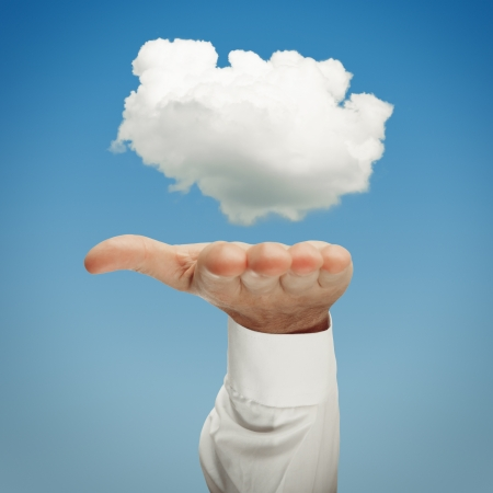 Cloud computing concept with hand presenting cloud photo