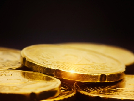 gold coins: Gold coins macro on black