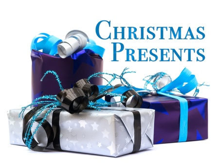 Christmas presents on white background with text photo