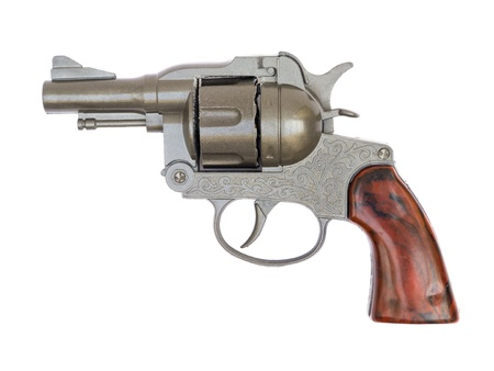 Old alarm pistol isolated on white photo