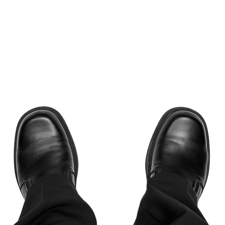looking out: Business man feet isolated on white Stock Photo