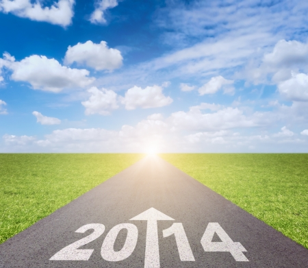 passing the road: Forward to 2014 concept with date and arrow on road Stock Photo