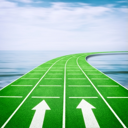 Forward concept with arrows on running track in ocean photo
