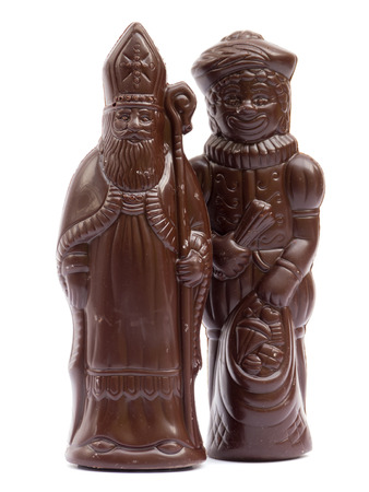 Saint Nicholas and Black Pete chocolate isolated on white photo