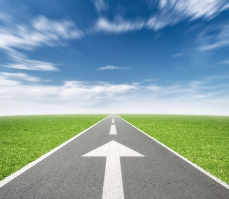 north arrow: Road with arrow in landscape, motion blur on clouds Stock Photo