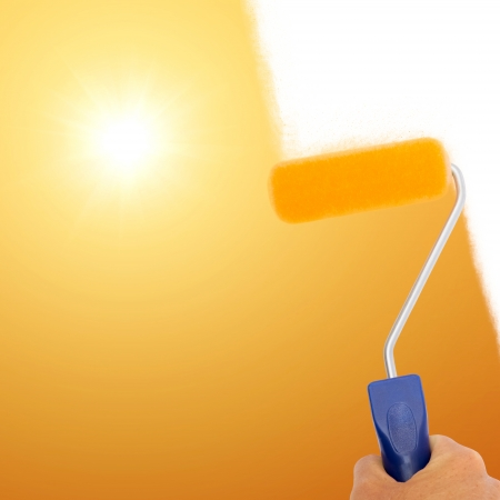Hand painting sunset with paint roller Stock Photo - 24041176