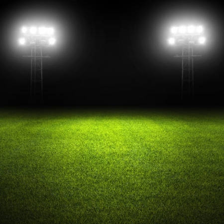 Soccer field template with grass and stadium lights photo