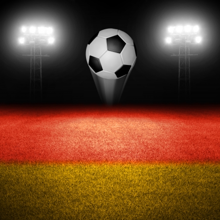 Soccer ball above field with german flag and illuminated stadium lights in background photo