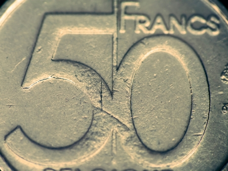 Fifty francs coin macro, selective focus, toned image photo