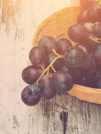 warmth: Red grapes in basket, vintage toned with sunlight