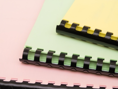 ring binder: Three colorful ring notebooks staple