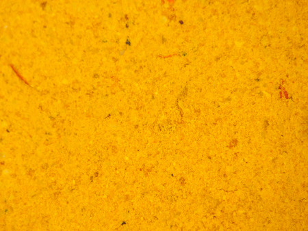 Ground turmeric overhead view for texture  photo