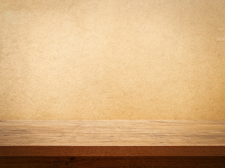 wooden furniture: Wooden table on grunge wall  Stock Photo