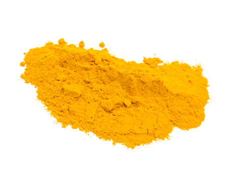 Ground turmeric isolated on white photo