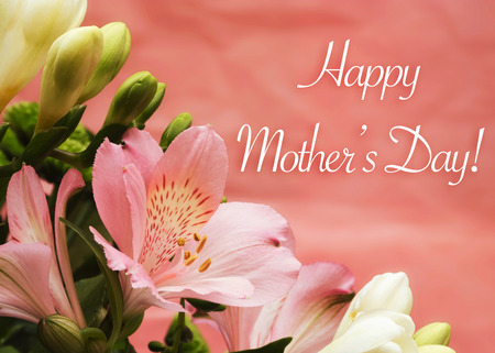 Mother day card with flowers and greeting on pink background photo