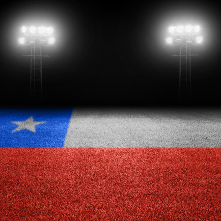 chilean flag: Chilean flag field with illuminated stadium lights in background