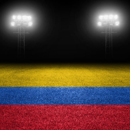 colombian: Colombian flag field against stadium lights Stock Photo