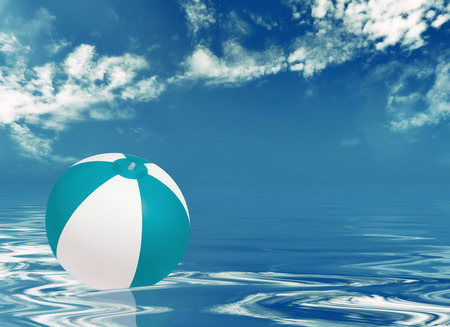 ball on water: Beach ball in water against cloudy sky Stock Photo
