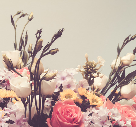 Flower bouquet on gray background, vintage toned photo