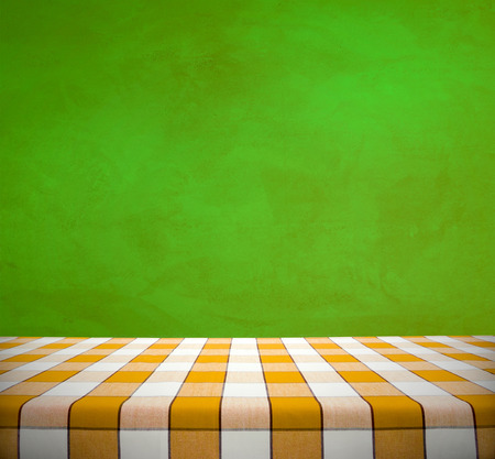 Yellow Checkered Tablecloth On Green Wall Background Stock Photo, Picture  And Royalty Free Image. Image 33117819.