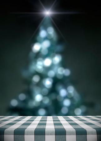 christmas lights display: Dining table on blue lit christmas tree bokeh with star