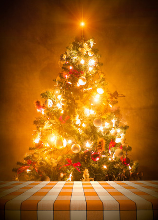holiday lights display: Dining table cloth against lit christmas tree