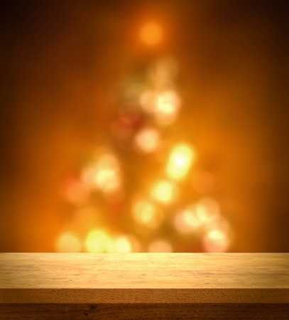 christmas lights display: Wooden table on christmas tree bokeh background Stock Photo