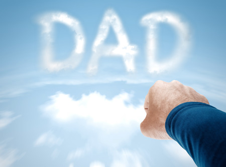 dad: Super dad concept with superman arm flying towards clouds spelling DAD