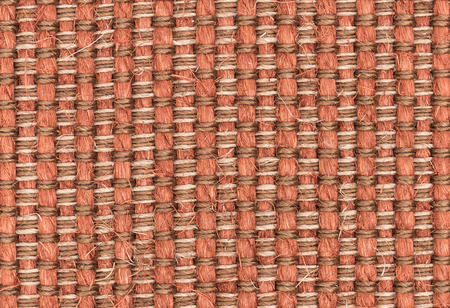 synthetic fiber: Red synthetic woven carpet closeup for texture or background