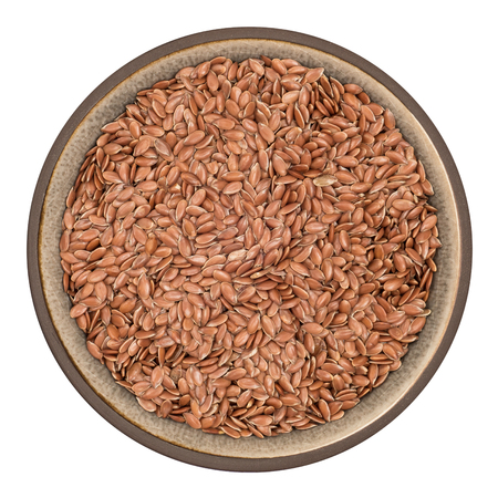 usitatissimum: Bio organic flax seeds in ceramic bowl isolated on white background, top view Stock Photo