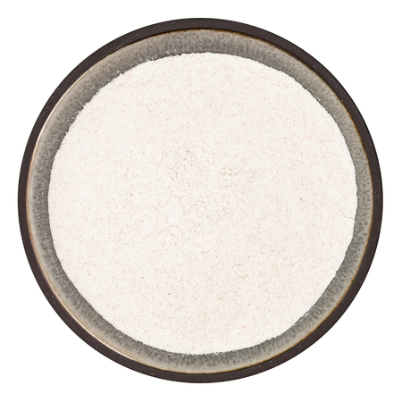 langosta: Bio organic locust bean gum powder in ceramic bowl isolated on white background, top view Foto de archivo