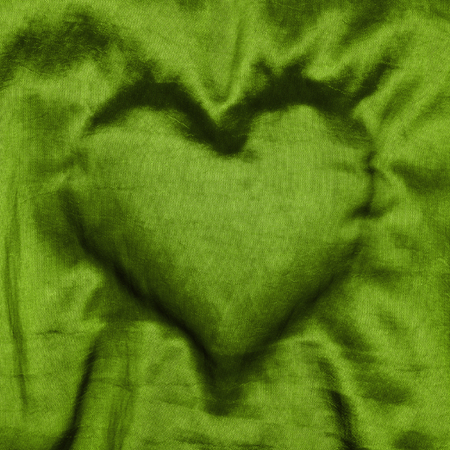 color of year: Heart shape in green cloth, greenery, color of the year 2017