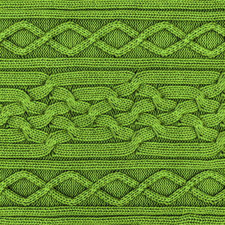 color of year: Green sweater woven pattern texture background, greenery color of the year 2017