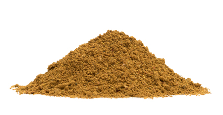 low angle: Bio organic ras el hanout spice pile isolated on white background, low angle view Stock Photo