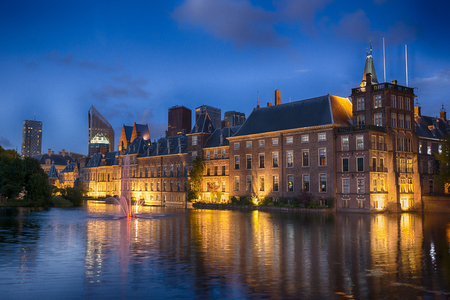 den: Dutch Parliament Building and Hofvijver in the Hague, Den Haag, the Netherlands, at night