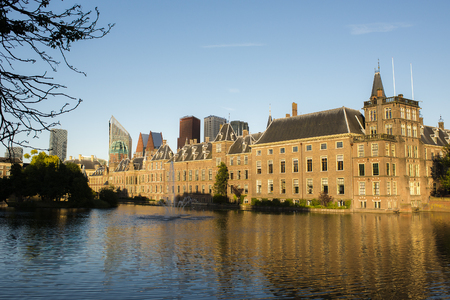 den: Dutch Parliament Building and Hofvijver in the Hague, Den Haag, the Netherlands, on a sunny evening