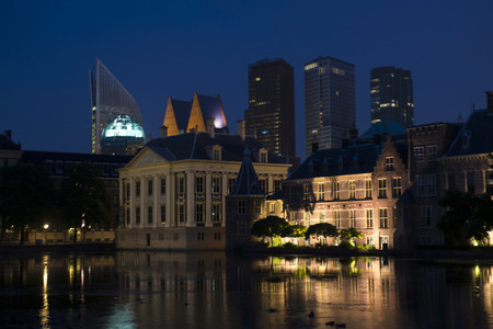 parliament building: View on Mauritshuis, Museum, and a part of Binnenhof, the Dutch Parliament Building in the Hague, the Netherlands at night. In the Background the Skyline of the Hague with Skyscrapers
