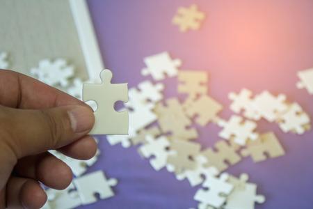 jigsaw puzzle Incomplete puzzlesand Фото со стока