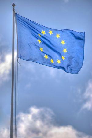 eu flag on cloudy sky backgrund  Stock Photo