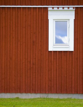 red wall with toilet window